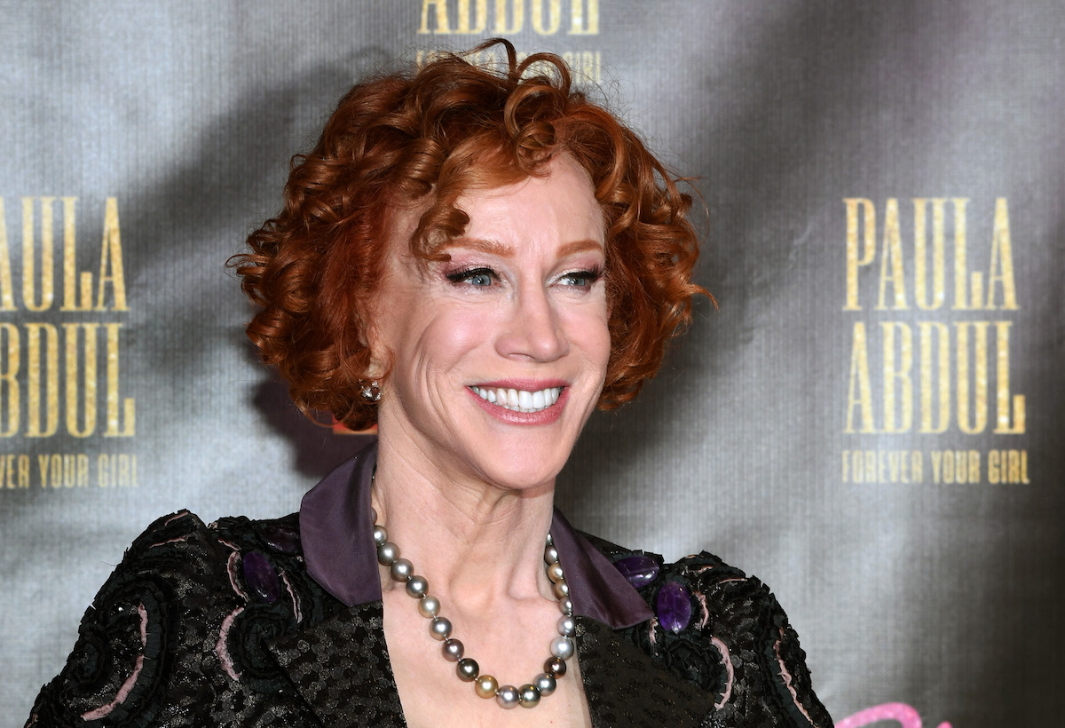 Kathy Griffin wearing a string of grey pearls