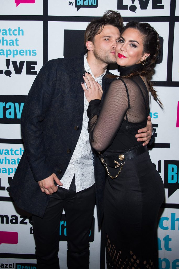 Tom Schwartz and Katie Maloney, wearing all black, get cozy at an event.