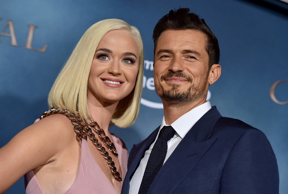 Katy Perry and Orlando Bloom smiling on the carpet together at premiere of Amazon's Carnival Row