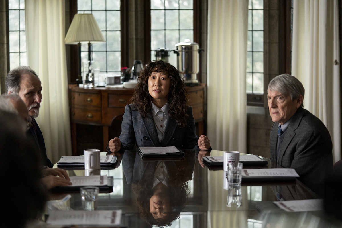 Sandra Oh sits at the head of a table next to Ken Bolden and Mark Philip Stevenson in 'The Chair' Season 1