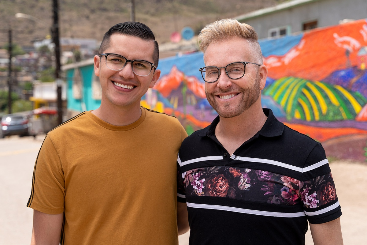 Kenneth and Armando post in front of mural in Mexico on 'The Other Way'