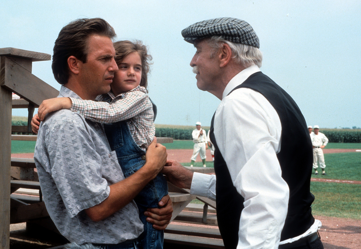 Ray holds daughter Karin while talking to Archibald Graham in 'Field of Dreams'