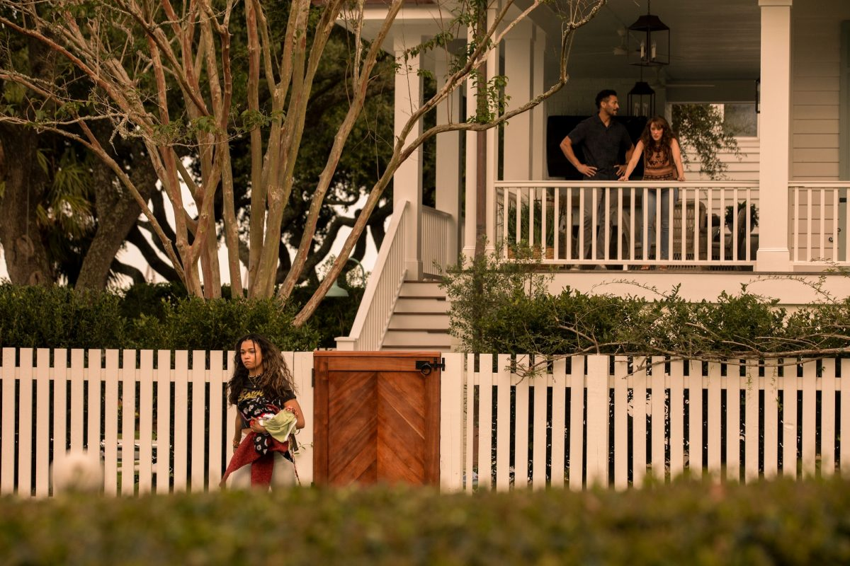 MADISON BAILEY as KIARA storming out of her parent's, played by MARLAND BURKE as MIKE, and SAMANTHA SOULE as ANNA, house in 'Outer Banks' Season 2