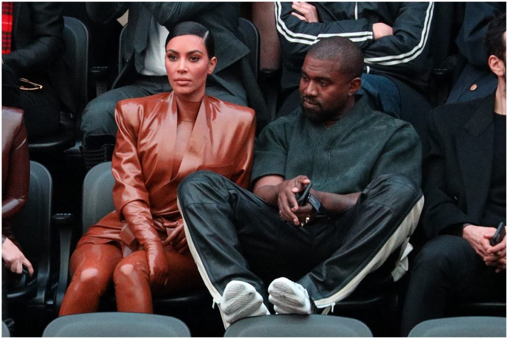 Kim Kardashian and Kanye West looking away while attending an event.