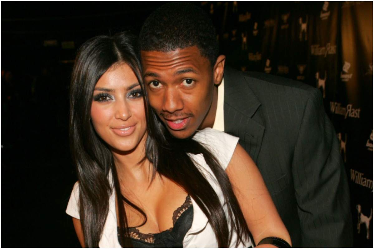 Kim Kardashian and Nick Cannon hugging and posing while attending an event.