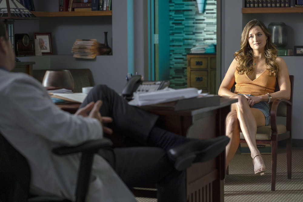 Grace Gummer seated in an office in a still from 'Dr. Death'