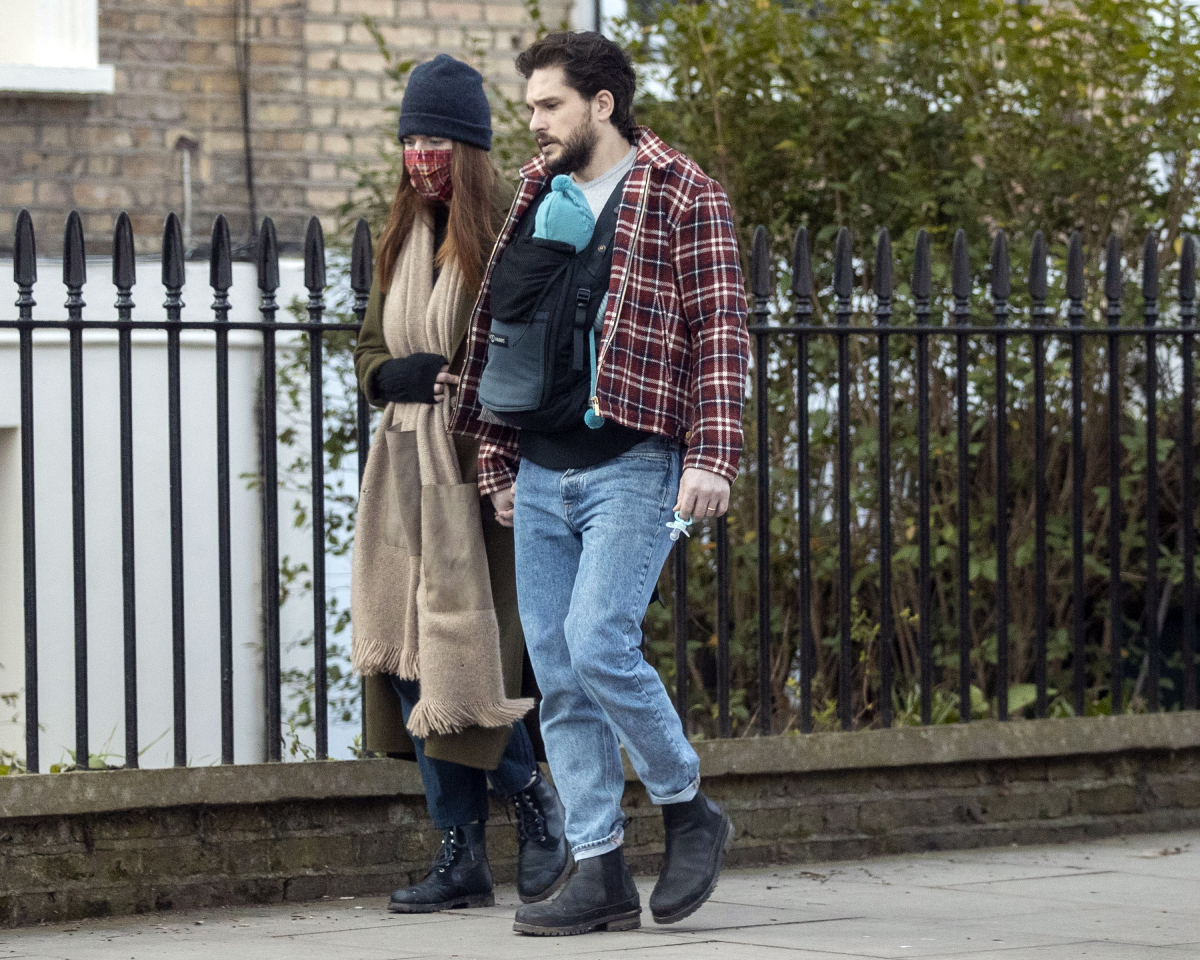 Kit Harington and Rose Leslie seen with their baby boy on a walk in North London on February 24, 2021 in London, England
