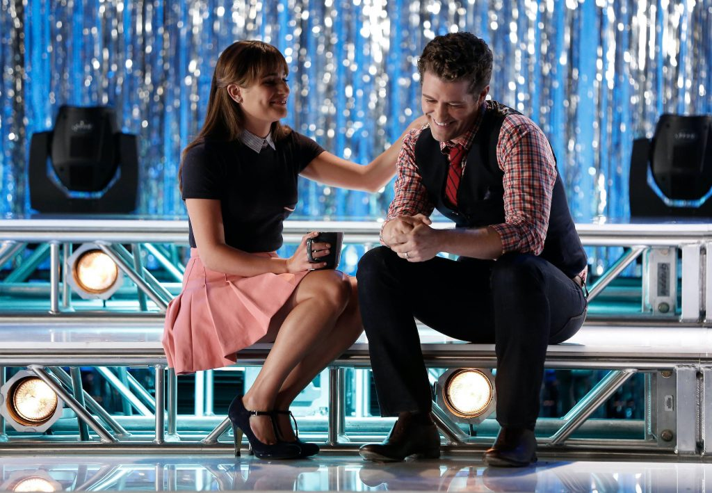 Lea Michele and Matthew Morrison smiling on 'Glee'