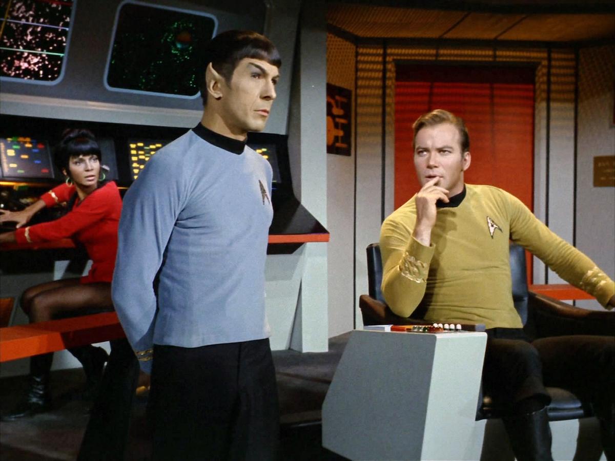 Leonard Nimoy as Spock, William Shatner as James Kirk, and Nichelle Nichols as Nyota Uhura in 'Star Trek'