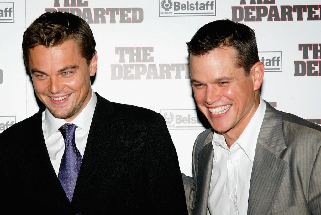Leonardo DiCaprio and Matt Damon laugh on the red carpet of 'The Departed' in 2006