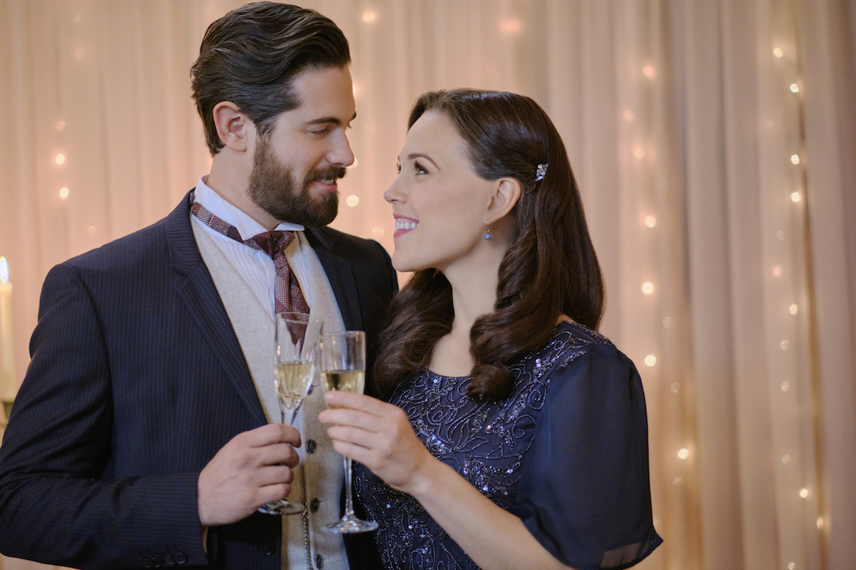 Lucas and Elizabeth, holding glasses of Champagne, in 'When Calls the Heart' Season 8