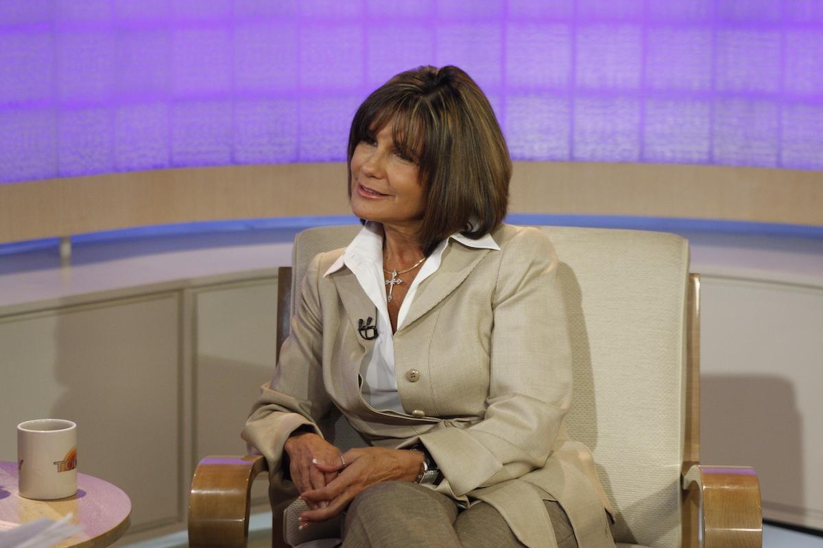 Lynne Spears in a beige suit