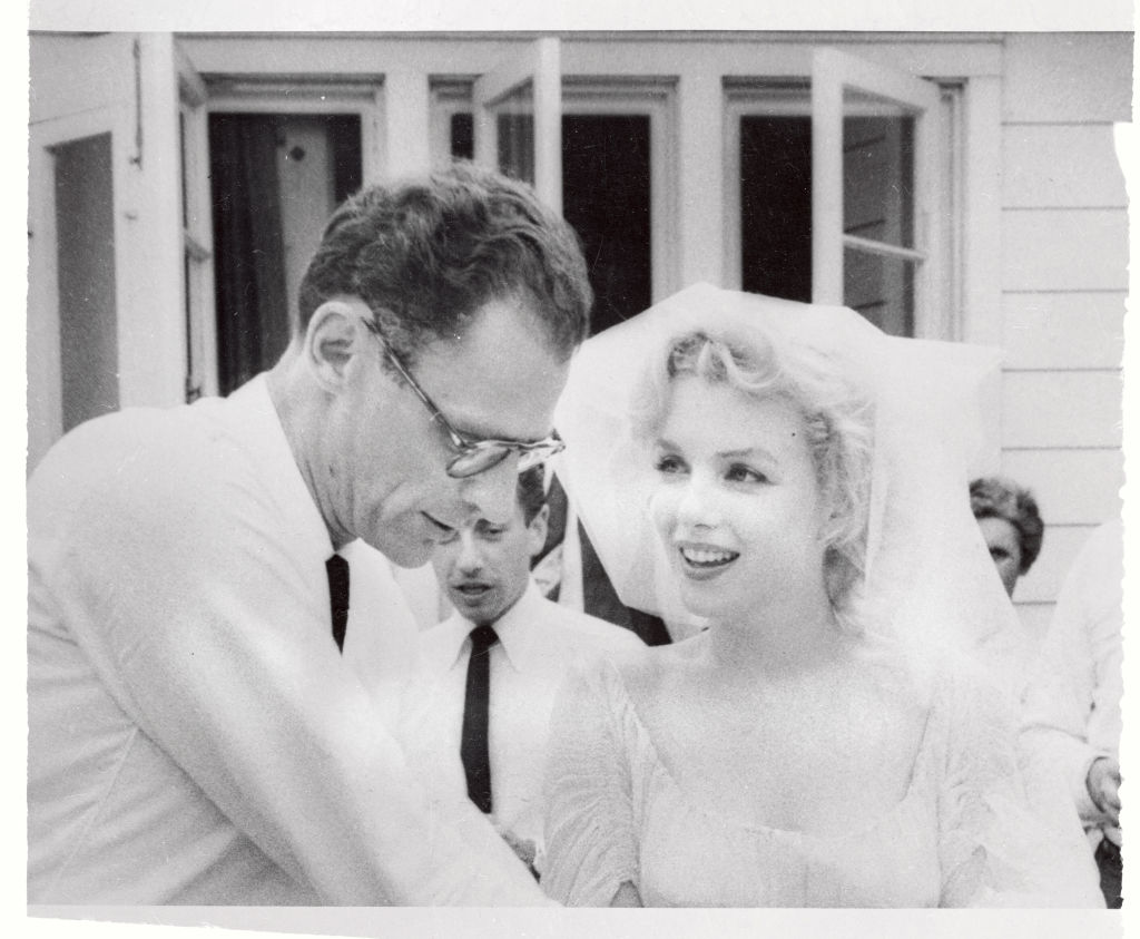 Monroe and Arthur Miller are shown in a black and white photo after their marriage ceremony, all smiles.