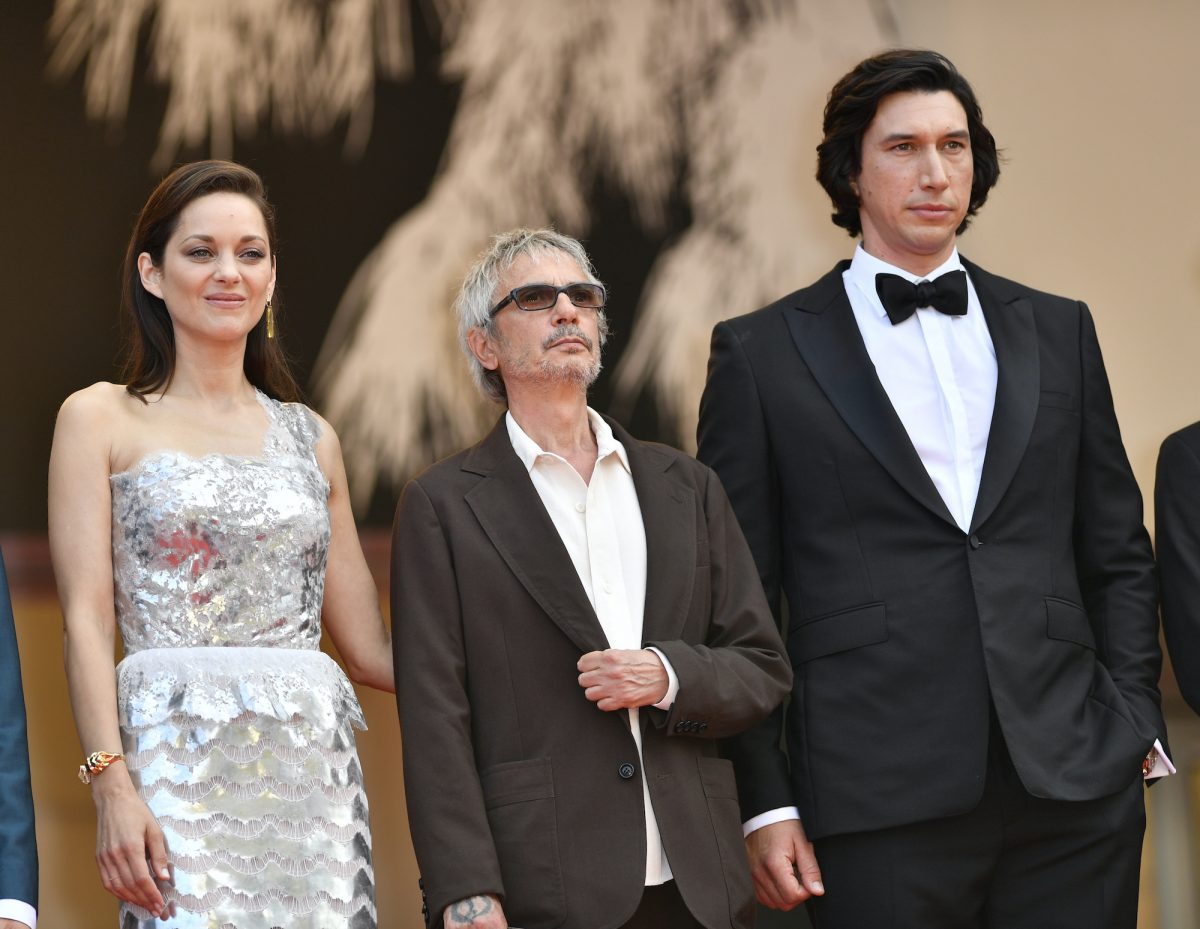 French actor Marion Cotillard, French film director Leos Carax, and US actor Adam Driver arrive for the screening of the film 'Annette' in competition and the Opening Ceremony of the 74th annual Cannes Film Festival