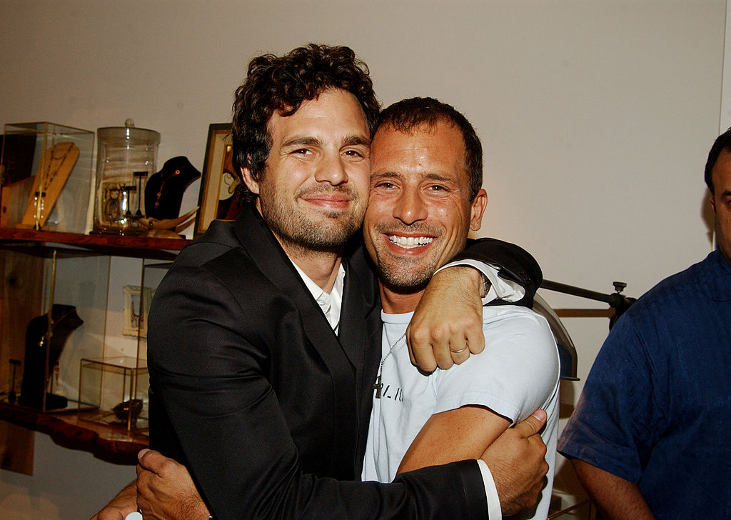 Mark Ruffalo and brother Scott  are all smiles as they hug each other, facing the camera.