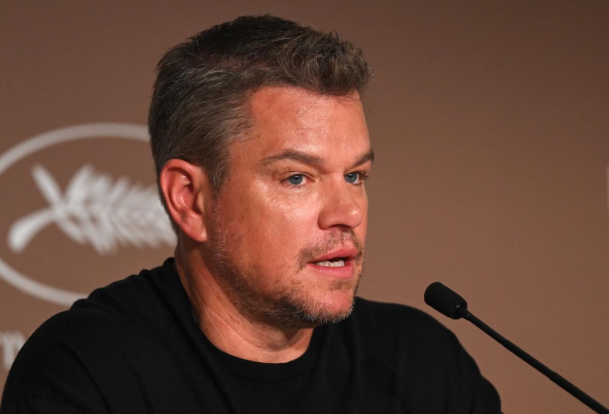 Matt Damon speaks into a microphone