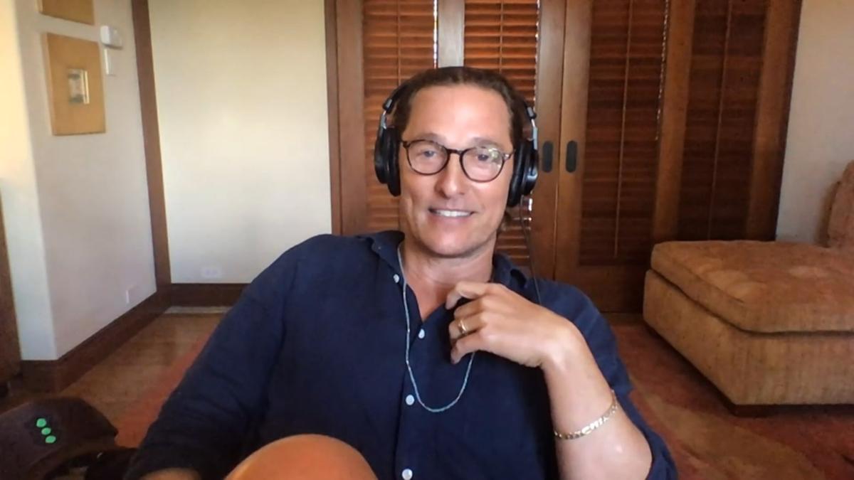 Matthew McConaughey wearing headphones sitting in a room