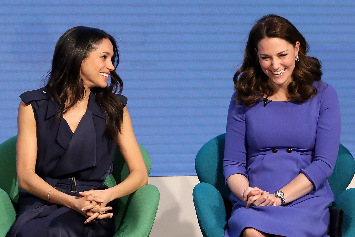 Meghan Markle and Kate Middleton laughing at the Royal Foundation Forum