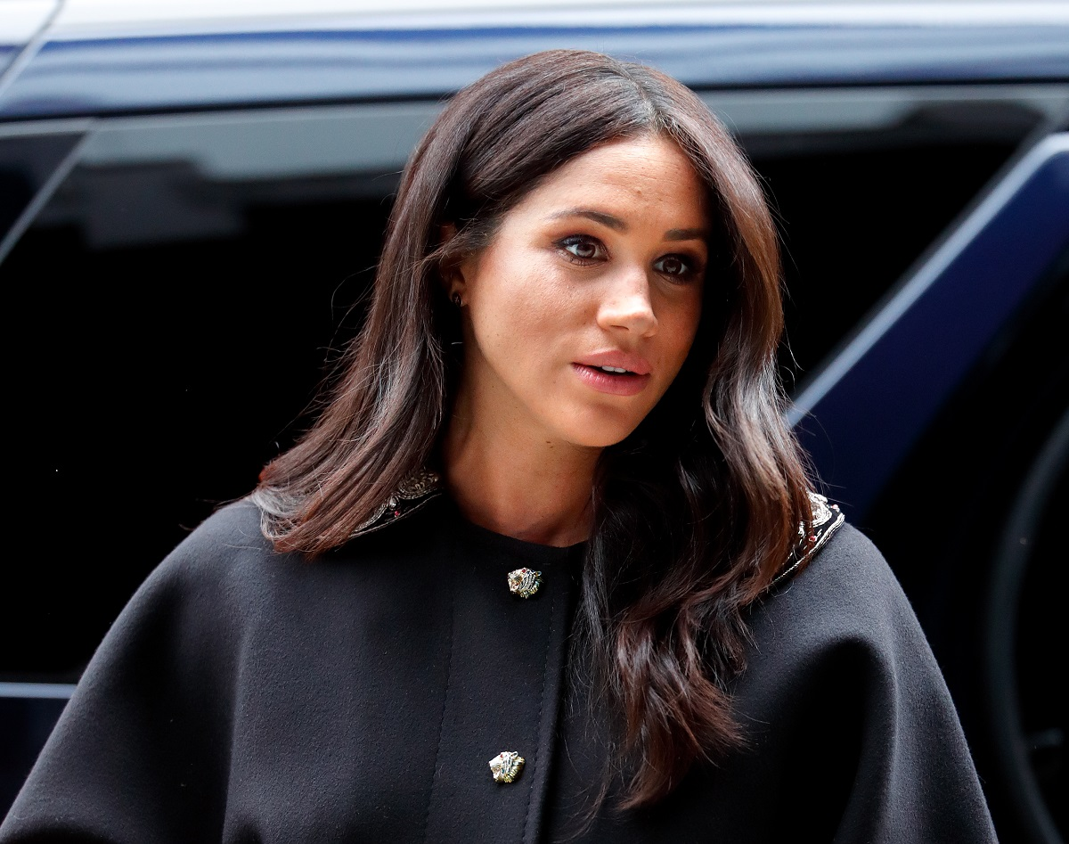 Meghan Markle wearing a black coat on a visit to New Zealand House