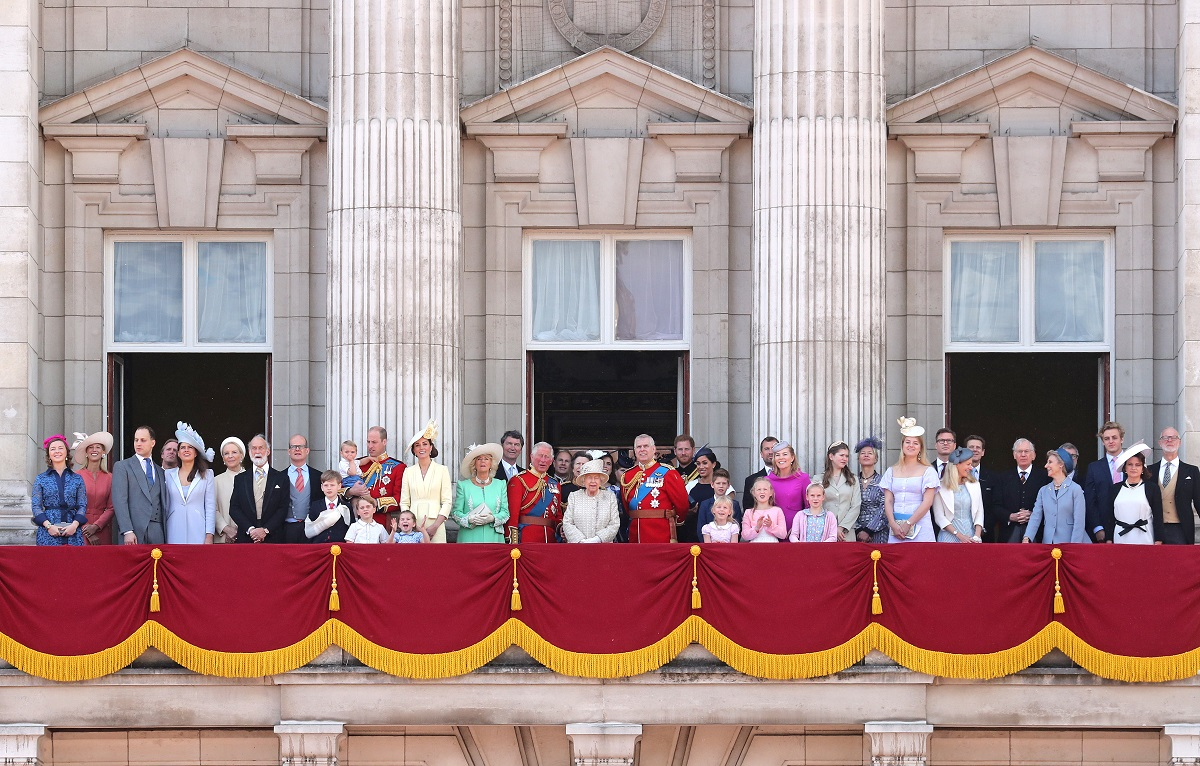 Members of Britain's royal family standing on the balcony of Buckingham Palace to watch a fly-past