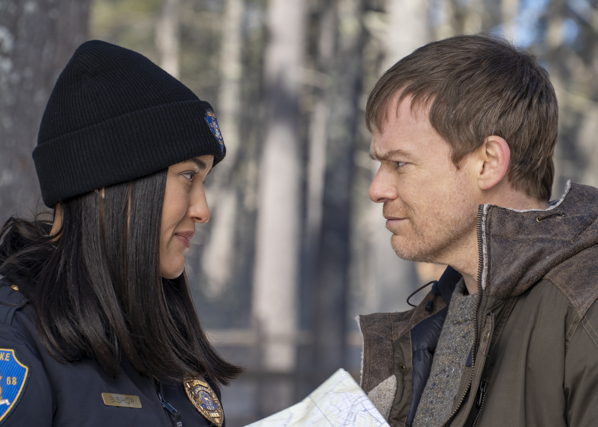 Michael C. Hall stands in the snow with Julia Jones