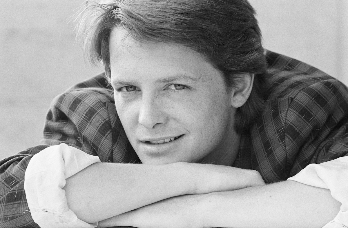 Michael J. Fox in a black and white photo looking at the camera