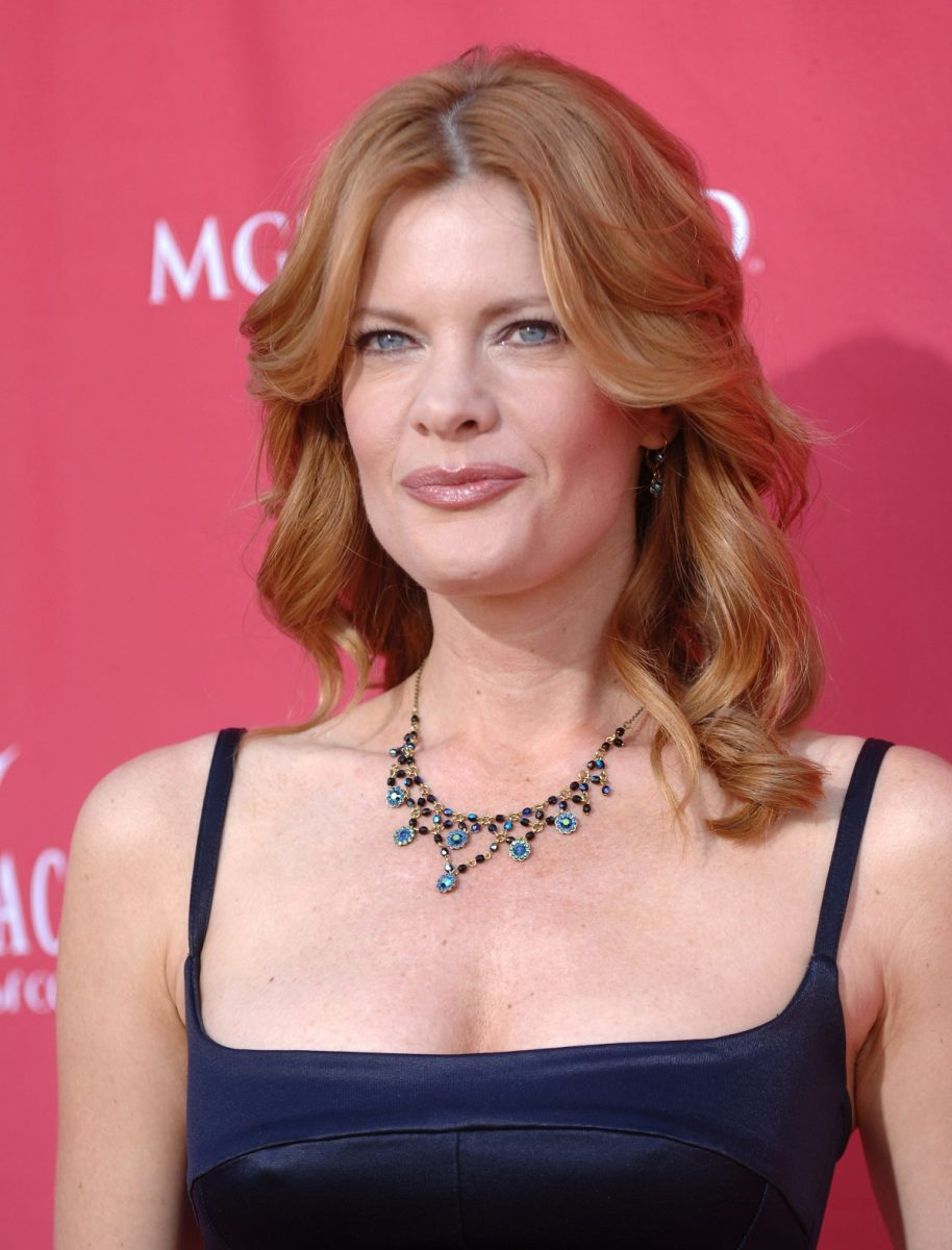 'The Young and the Restless' actor Michelle Stafford wears a black dress attending the 41st Annual American Country Music Awards.
