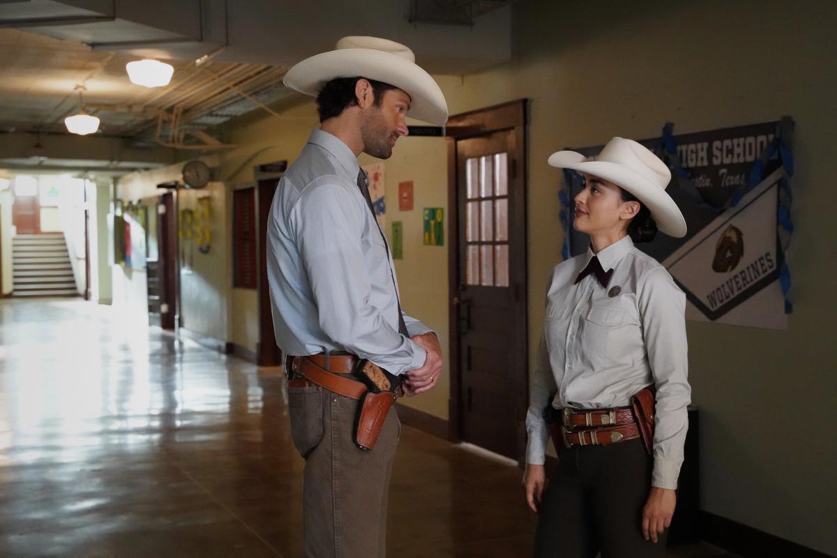 Micki Ramirez and Cordell Walker talk in the school