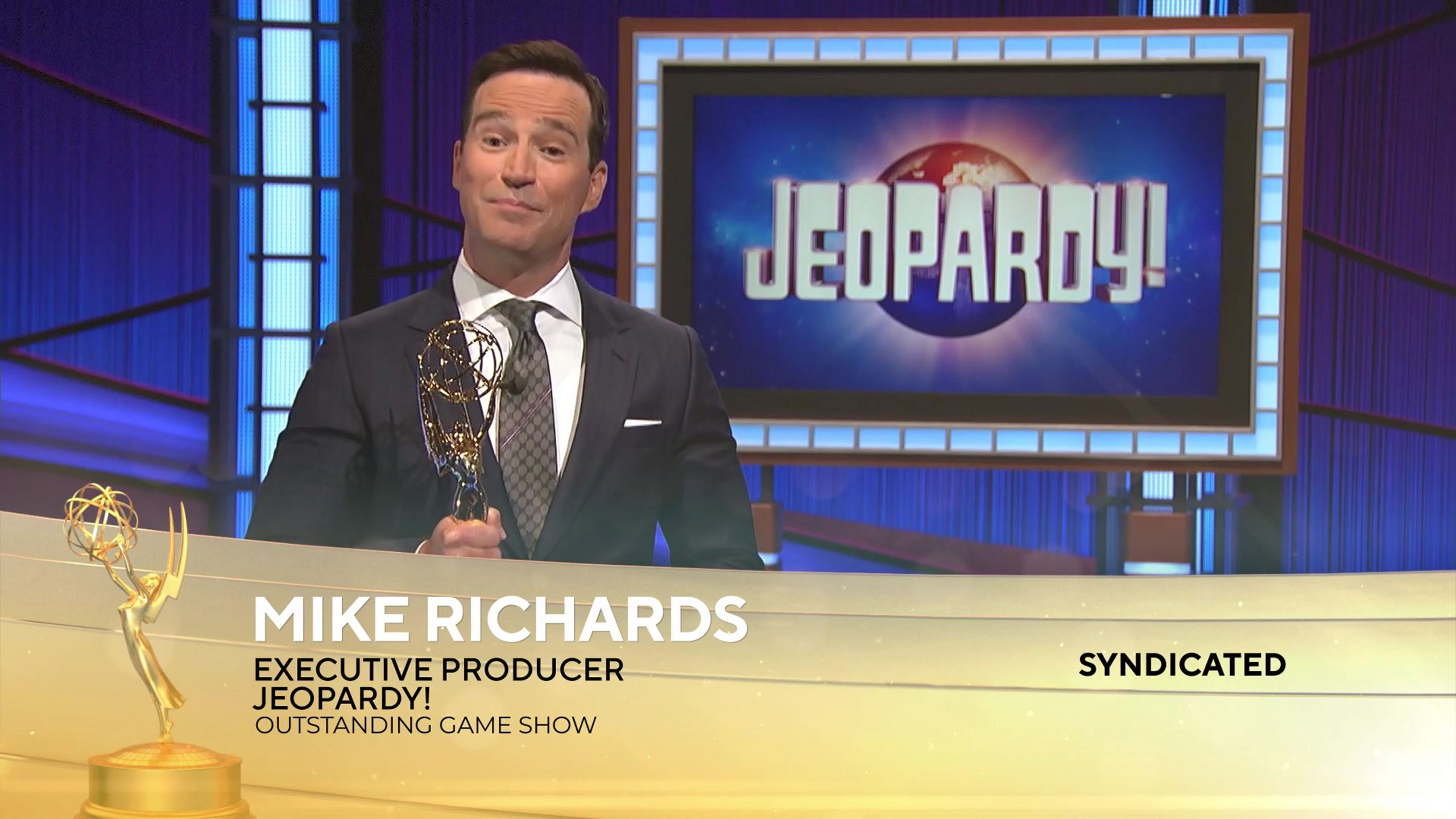 'Jeopardy!' executive producer Mike Richards accepts a 2021 Emmy for the game show.