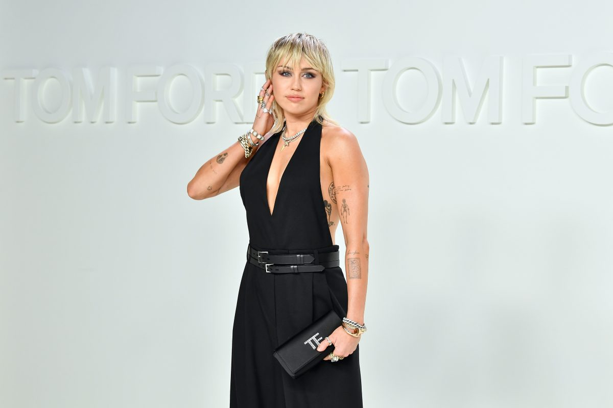 Miley Cyrus posing at the Tom Ford AW20 Show