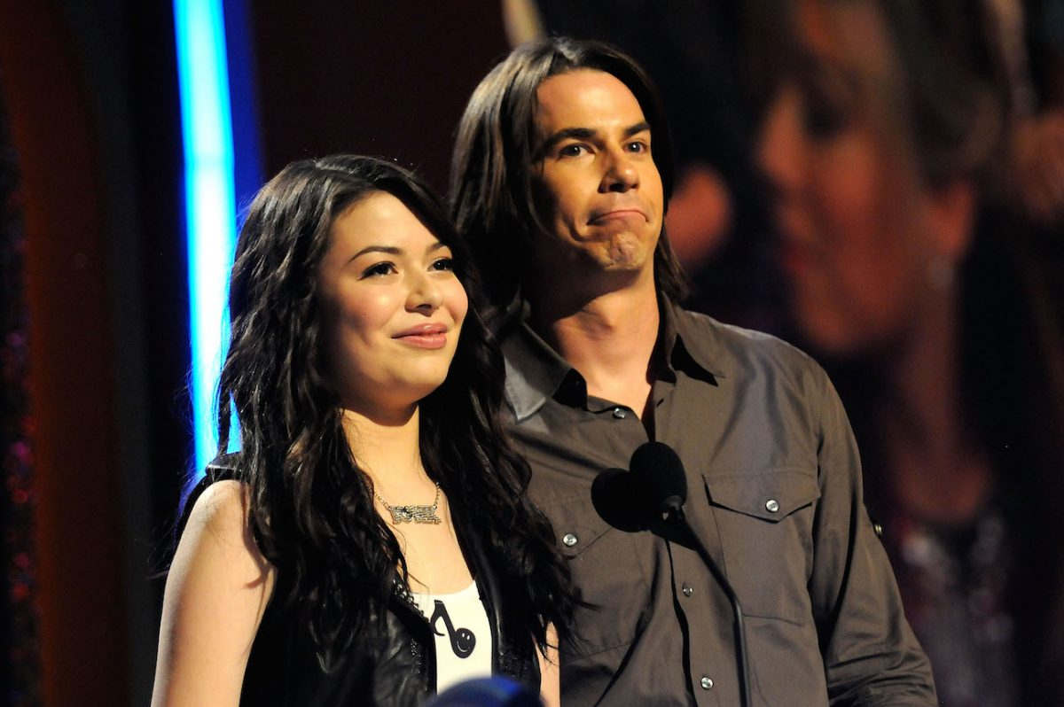 Miranda Cosgrove and Jerry Trainor speaking to an audience on stage