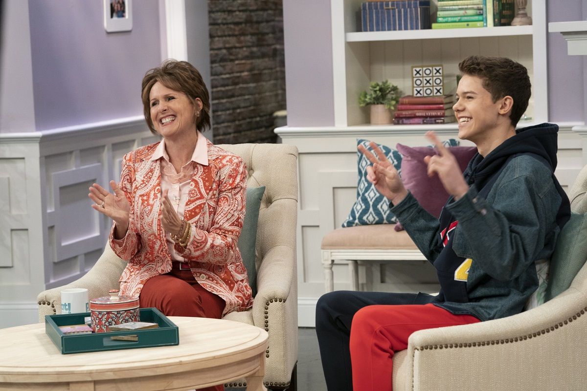 Molly Shannon and Case Walker sit on the set of 'The Pat Dubek Show' in 'The Other Two.'