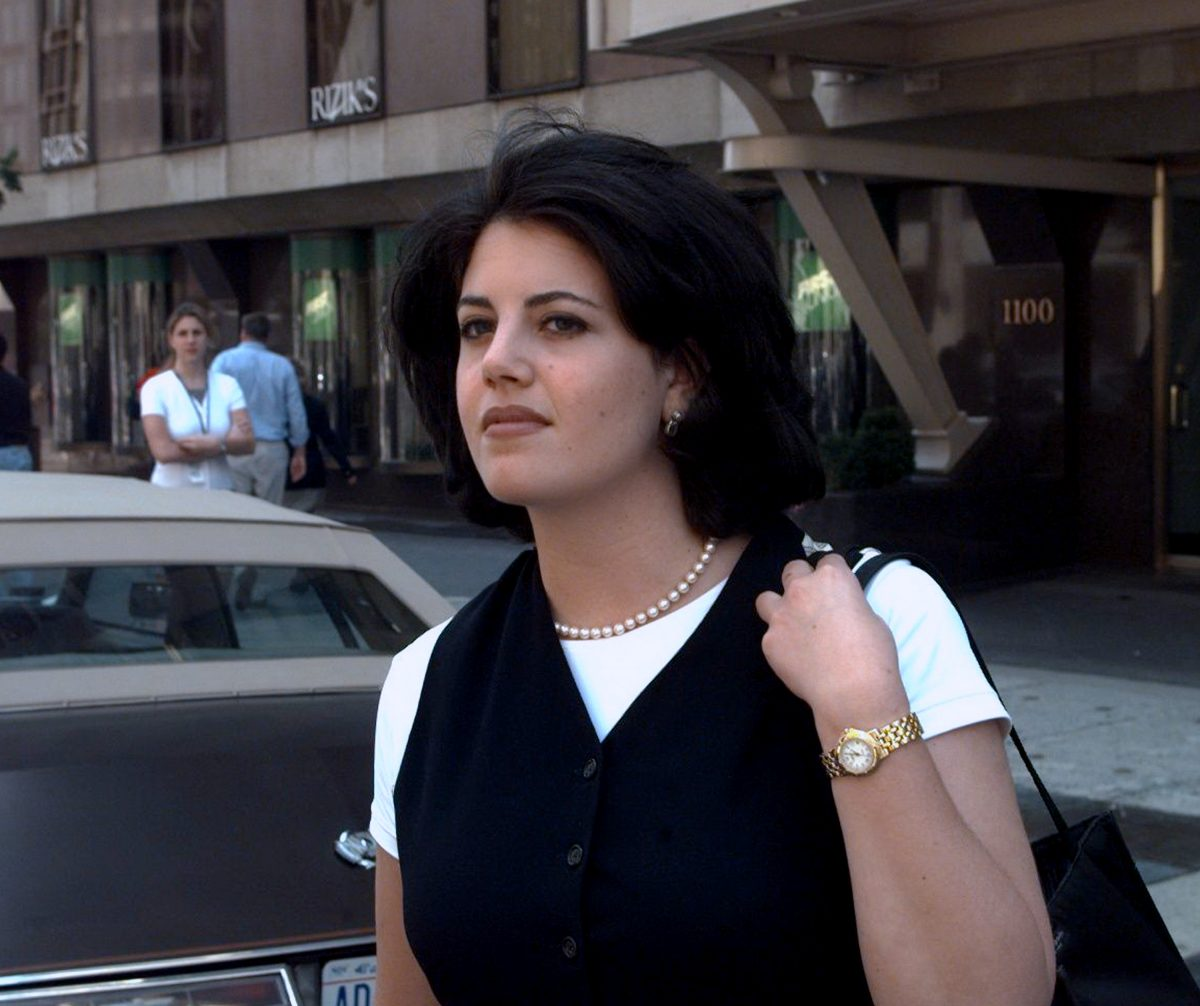 Monica Lewinsky wearing a white shirt and black vest in 1998