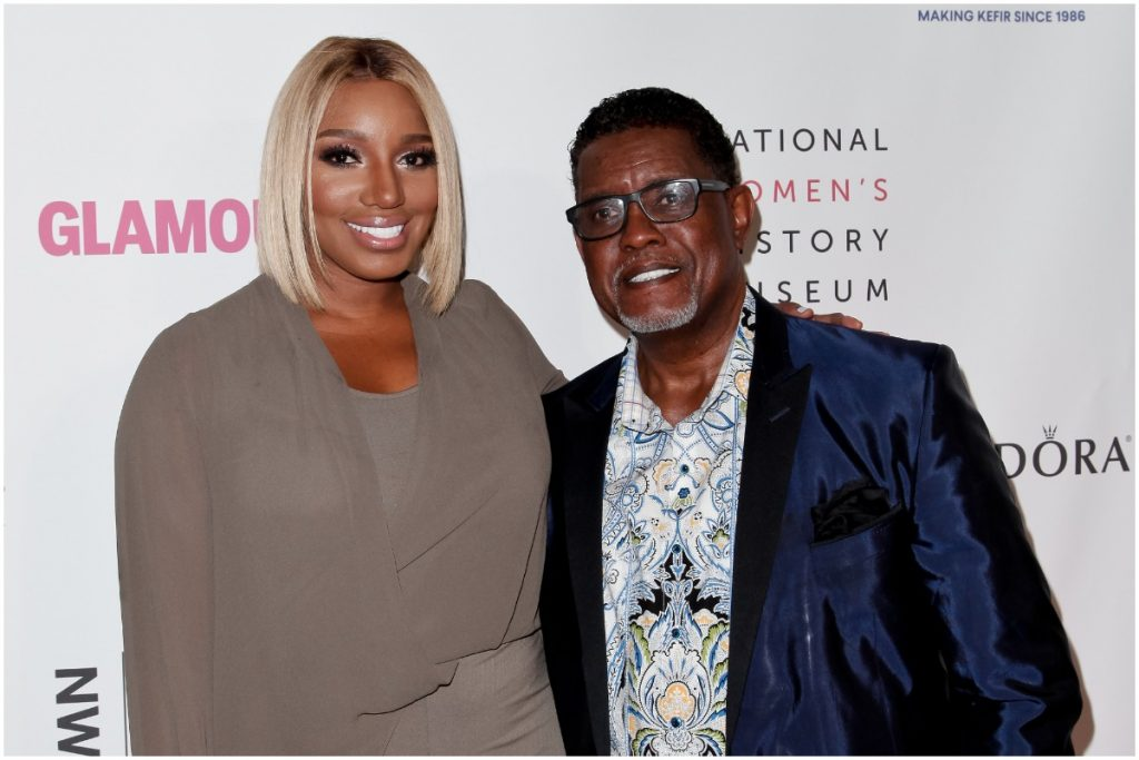 The Real Housewives of Atlanta: NeNe Leakes and Gregg Leakes embracing each other on the red carpet.