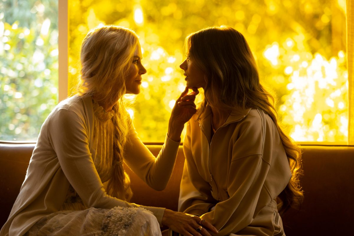 Nicole Kidman and Samara Weaving in 'Nine Perfect Strangers' on Hulu. Kidman and Weaving are sitting on the floor across from one another. Kidman is holding Weaving's chin. Series is also streaming on Amazon in certain countries.