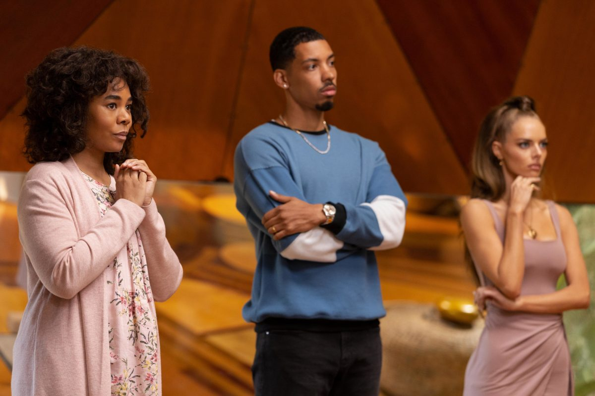 Carmel (Regina Hall), Ben (Melvin Gregg), and Jessica (Samara Weaving) from the cast of Hulu's 'Nine Perfect Strangers.' They're standing next to one another and looking confused at someone off-screen.