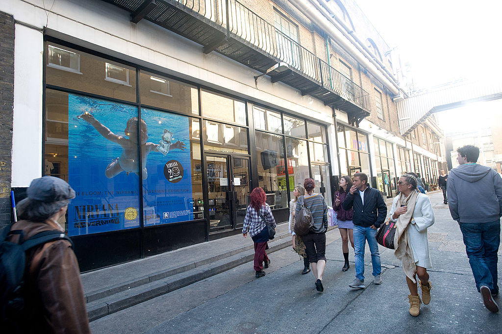 Passersby look at the giant album art for Nirvana's 'Nevermind' which is displayed on the window for the 20th anniversary exhibition.