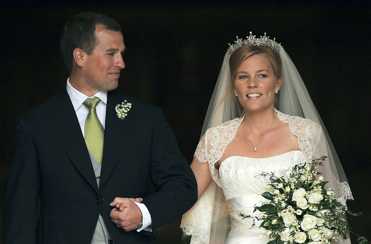 Peter Phillips and bride Autumn Kelly walking out of St. George's Chapel on their wedding day