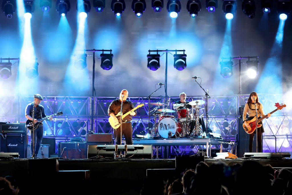 The Pixies performing on stage