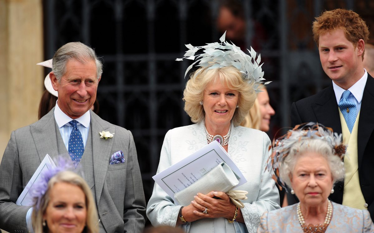 Prince Charles, Camilla Parker Bowles, Prince Harry, and Queen Elizabeth II attending Peter Phillips and Autumn Kelly's wedding
