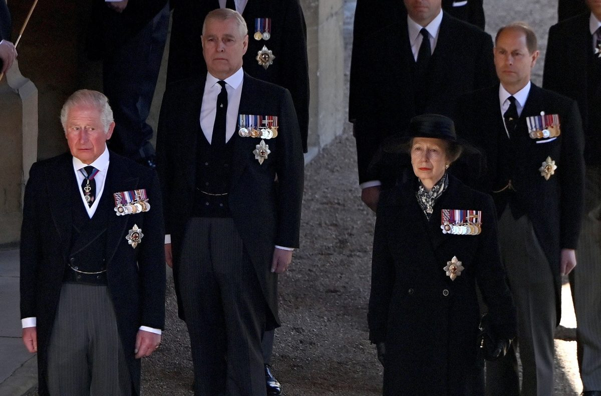 Prince Charles, Princess Anne, Prince Andrew, and Prince Edward follow Prince Philip's coffin