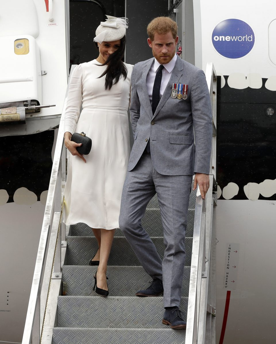 Prince Harry and Meghan Markle getting off plane after landing in Fiji