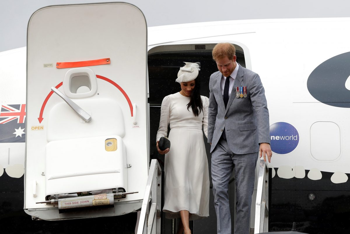 Prince Harry and Meghan disembark from plane upon arrival in Suva