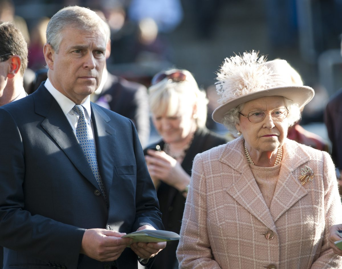 Queen Elizabeth II and Prince Andrew standing next to one another at Ascot Racecourse