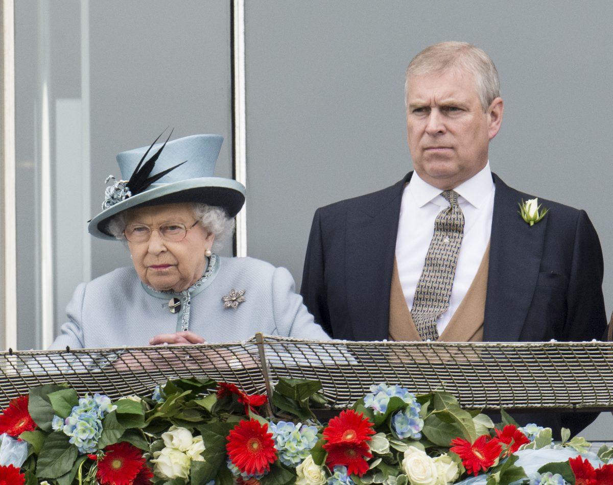 Queen Elizabeth II and Prince Andrew watching horses race at The Investec Derby Festival