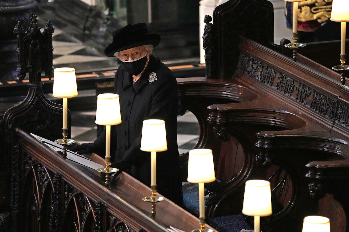 Queen Elizabeth II wears a face mask at Prince Philip's funeral in April 2021
