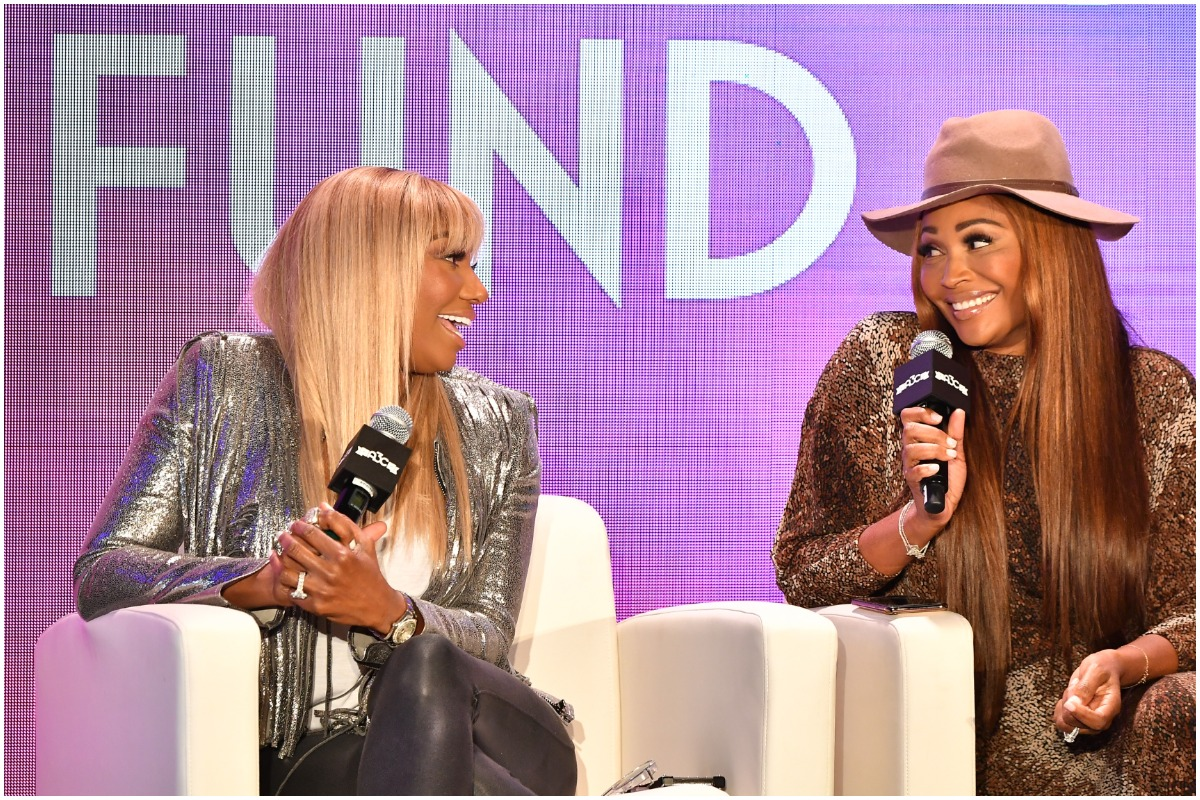 RHOA: NeNe Leakes and Cynthia Bailey looking at each other while laughing onstage.