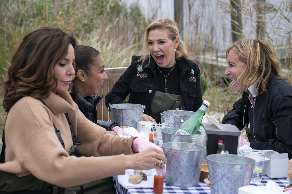 Luann de Lesseps, Eboni K. Williams, Ramona Singer, and Sonja Morgan have dinner on The Real Housewives of New York City
