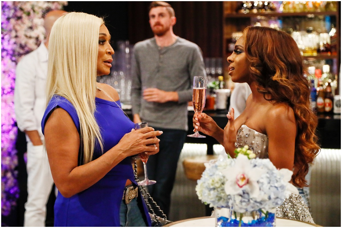 'Real Housewives of Potomac' stars Karen Huger and Candiace Dillard having a conversation while at an event.