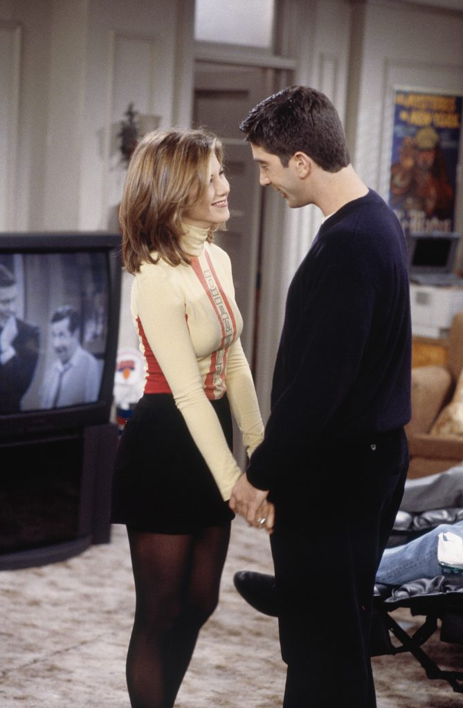Rachel and Ross hold hands and look into each other's eyes.